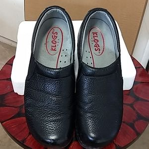 Klogs, black leather shoes.